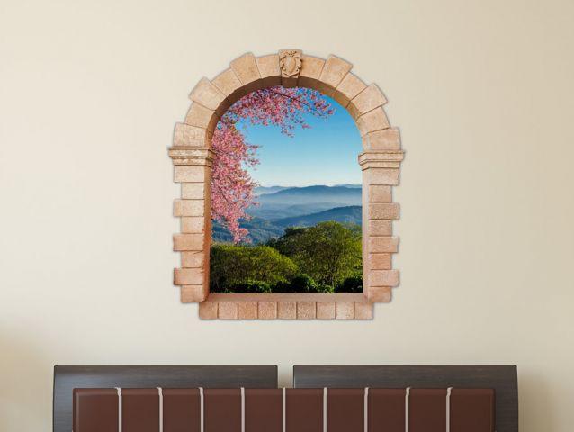 חלון עתיק להרים ועץ פורח