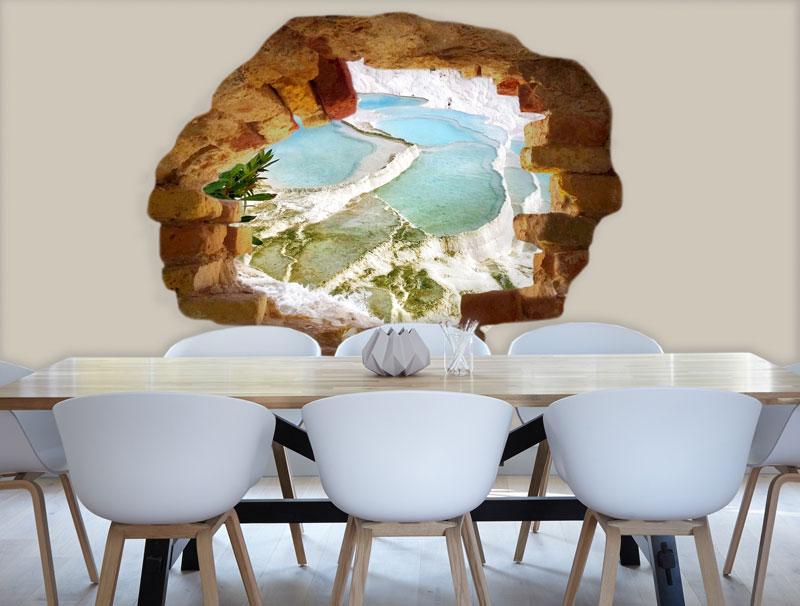 מדבקה של חור בקיר עם נוף לים