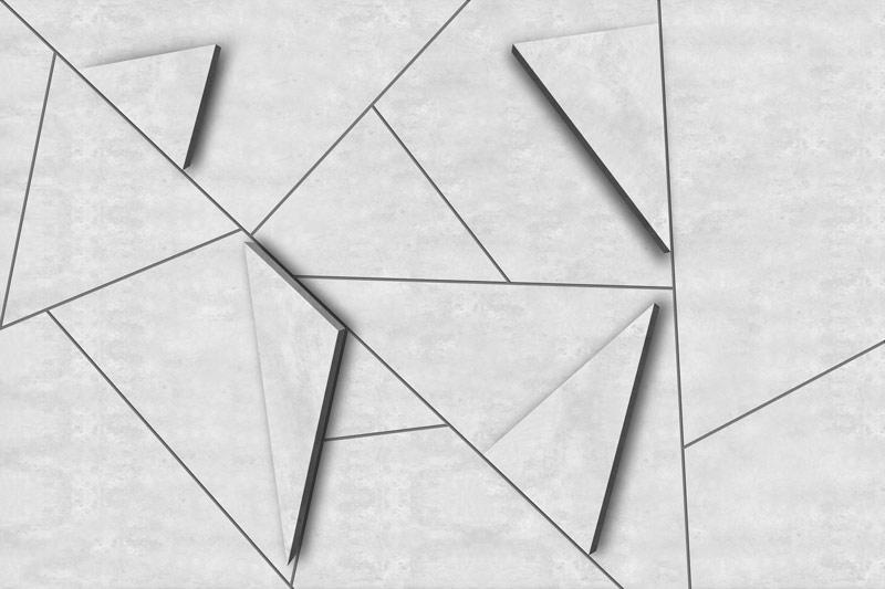 קיר בטון בהיר עם משולשי תלת מימד