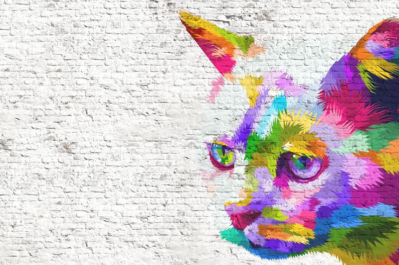 חתול בשלל צבעים על קיר בריקים