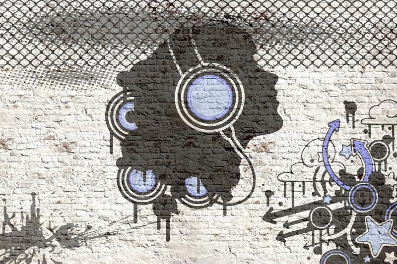 גרפיטי מוזיקלי על קיר בריקים בגוון כחול